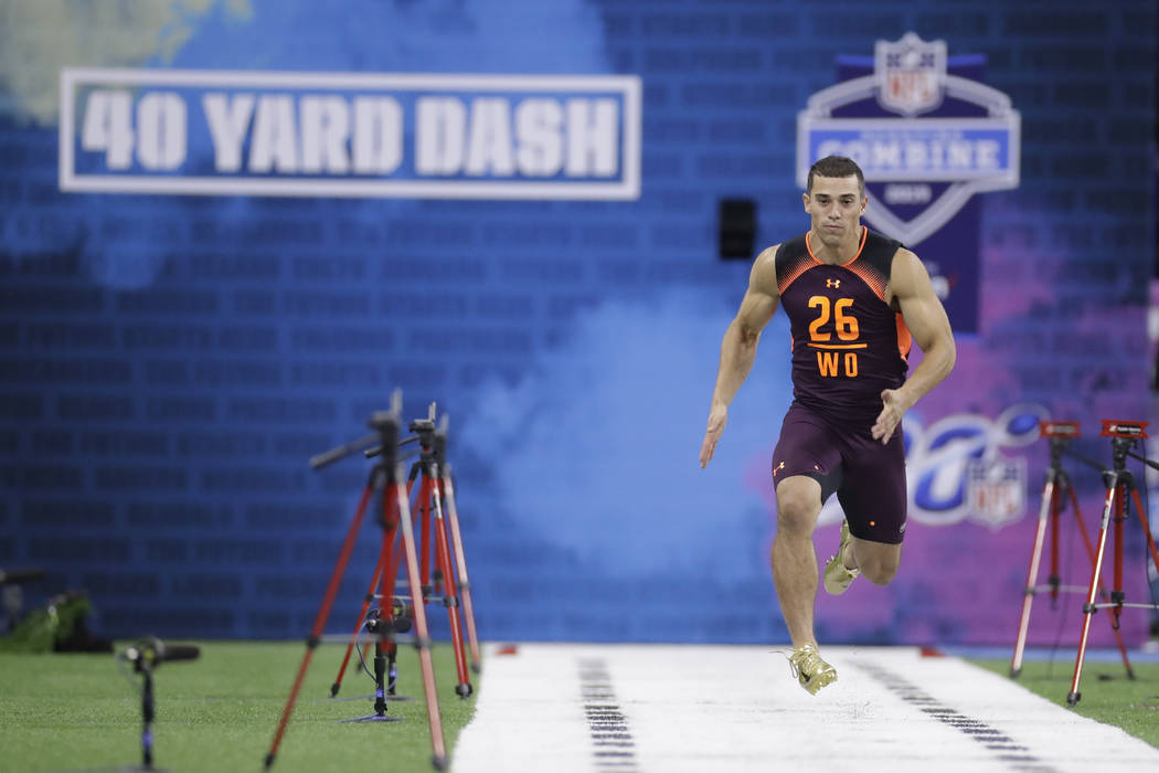 Massachusetts wide receiver Andy Isabella runs the 40-yard dash during the NFL football scoutin ...