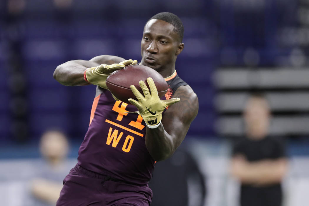 South Carolina wide receiver Deebo Samuel runs a drill at the NFL football scouting combine in ...