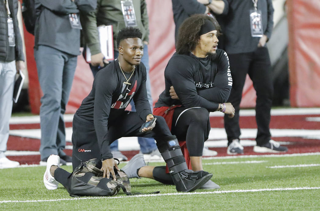 Oklahoma wide receiver Marquise Brown, left, and running back Rodney Anderson watch during the ...