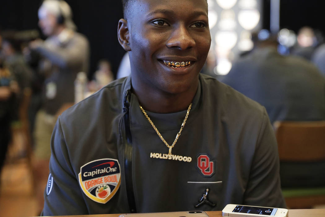 Oklahoma wide receiver Marquise Brown speaks to reporters during an NCAA college football media ...