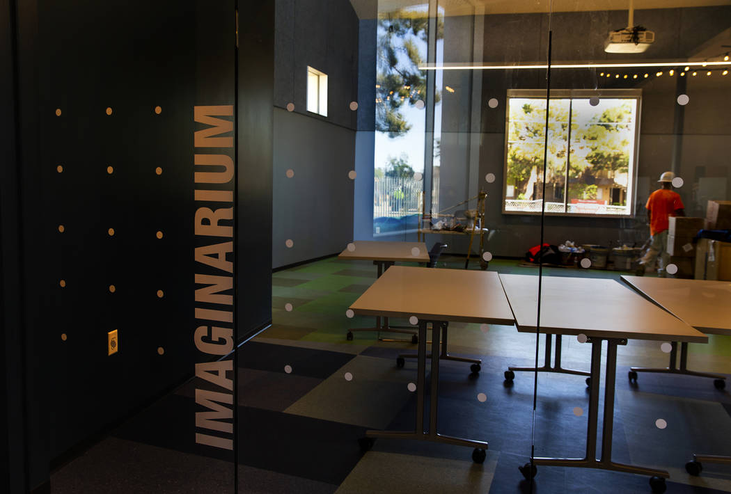 Work continues in the Imaginarium where kids can hear stories, create and play within the new E ...