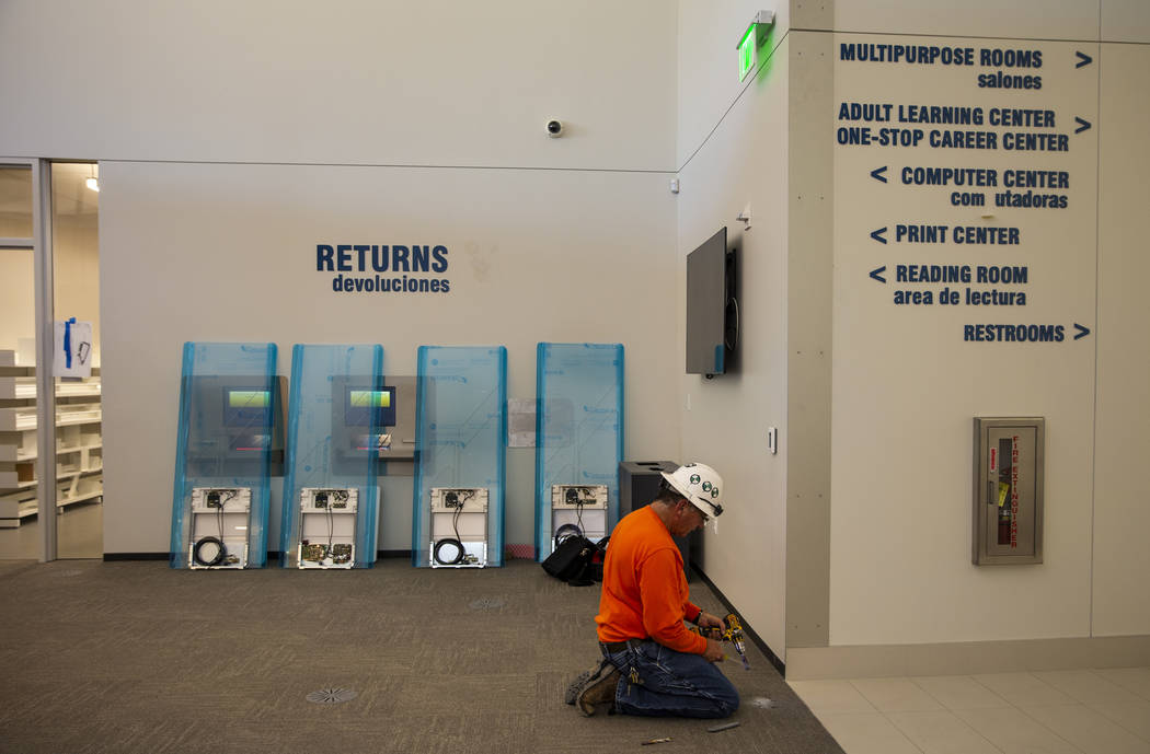 Directions to the various rooms are posted as work continues on the new East Las Vegas Library, ...