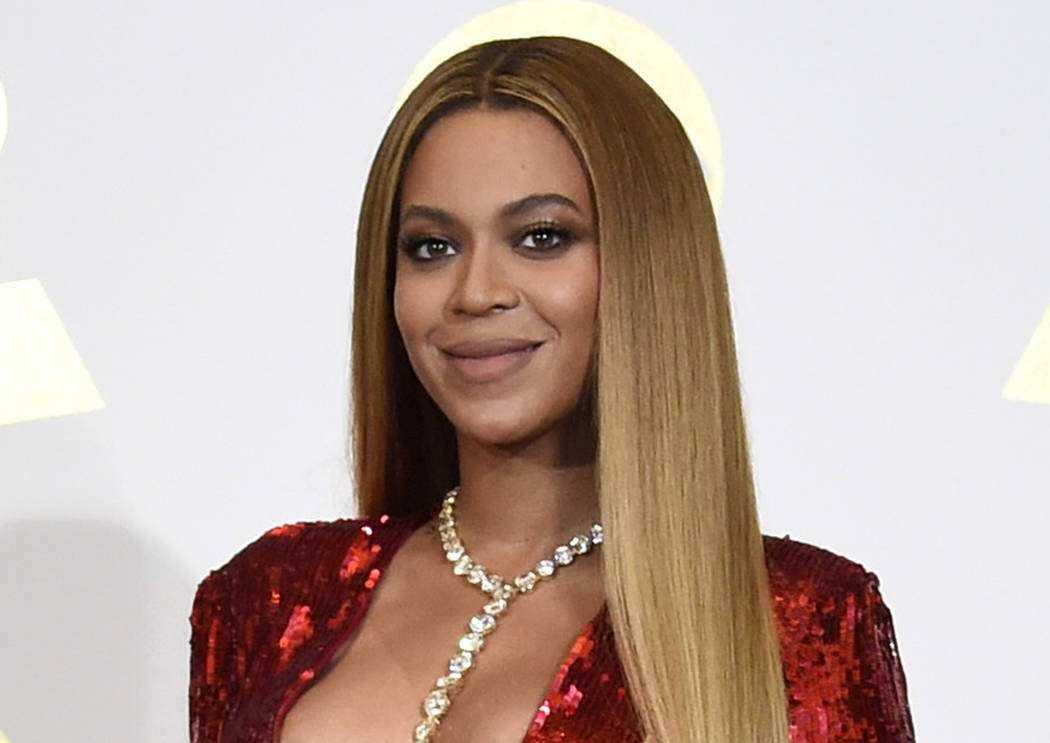 FILE - In this Feb. 12, 2017 file photo, Beyonce poses in the press room at the 59th annual Gra ...