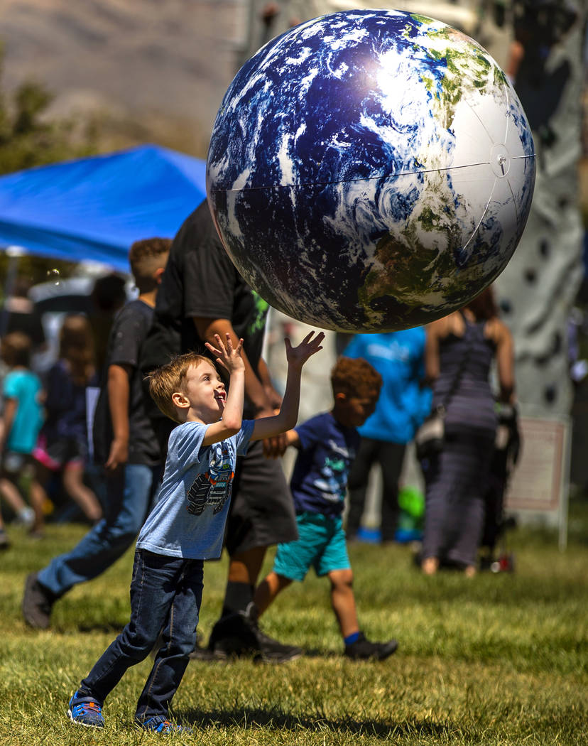 Adam Suarez, 4, attempts to catch the world in his hands as GREENFest celebrates its 10th anniv ...