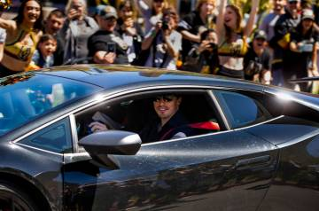 Golden Knights goaltender Marc-Andre Fleury smiles at fans while players depart City National A ...