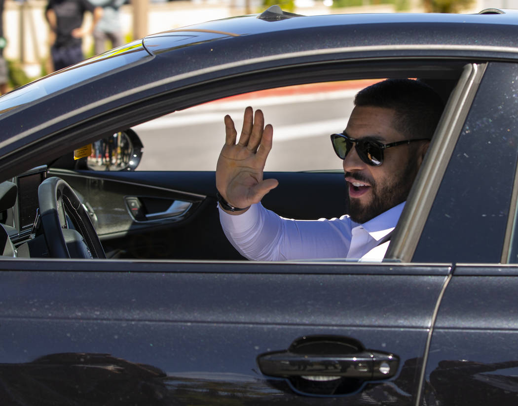 Golden Knights center Pierre-Edouard Bellemare smiles at fans while players depart City Nationa ...