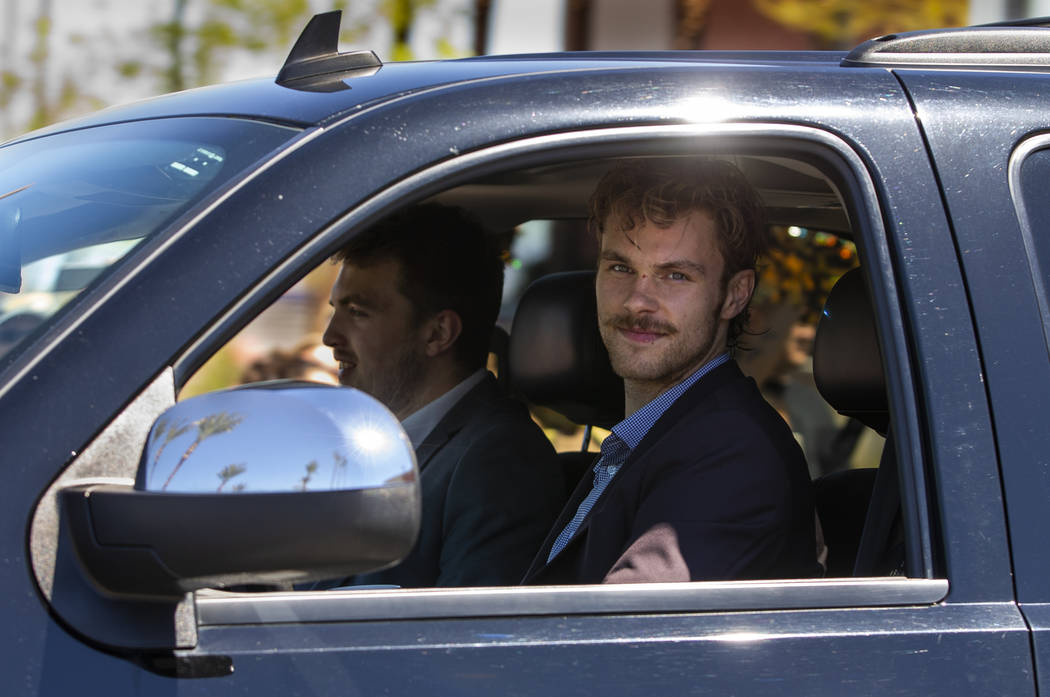 Golden Knights defenseman Jon Merrill looks to fans while departing City National Arena for San ...