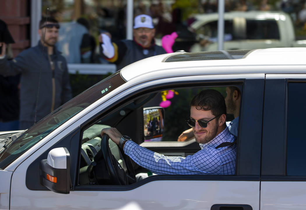Golden Knights defenseman Colin Miller smiles at fans while departing City National Arena for S ...