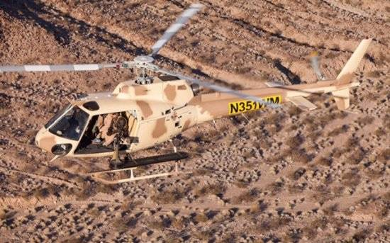 A helicopter flies over the Gunship Helicopters site in Sandy Valley, Nevada. (courtesy)