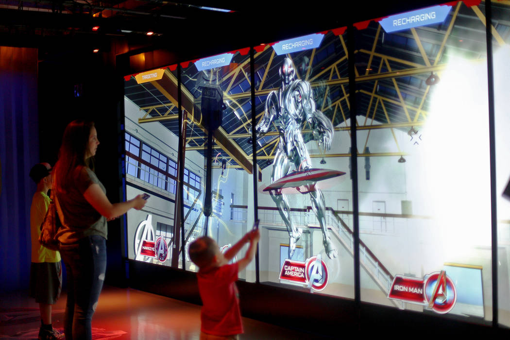 Guests play an interactive game at the Avengers S.T.A.T.I.O.N exhibit at Treasure Island hotel- ...