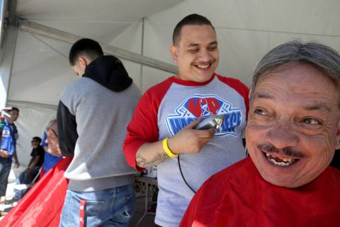 U.S. Navy veteran Fernando Gonzales, 56, and Sergio Bustillos, 30, share a laugh when they real ...