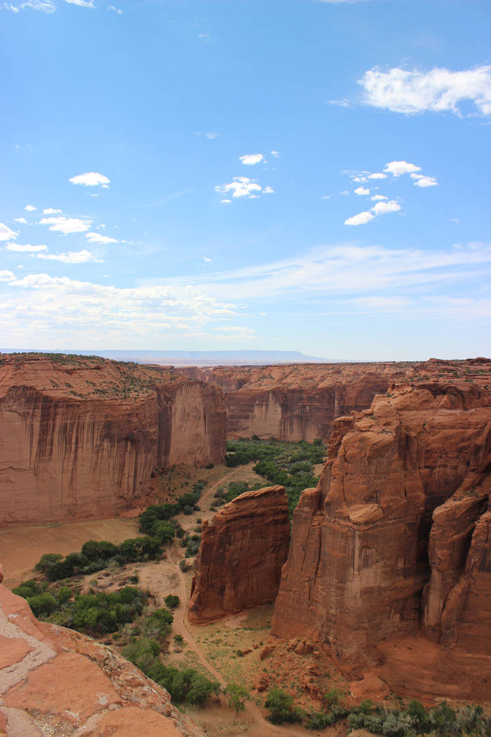 Red sandstone cliffs rise 1,000 feet from the valley floor in Canyon de Chelly. (Deborah Wall/L ...