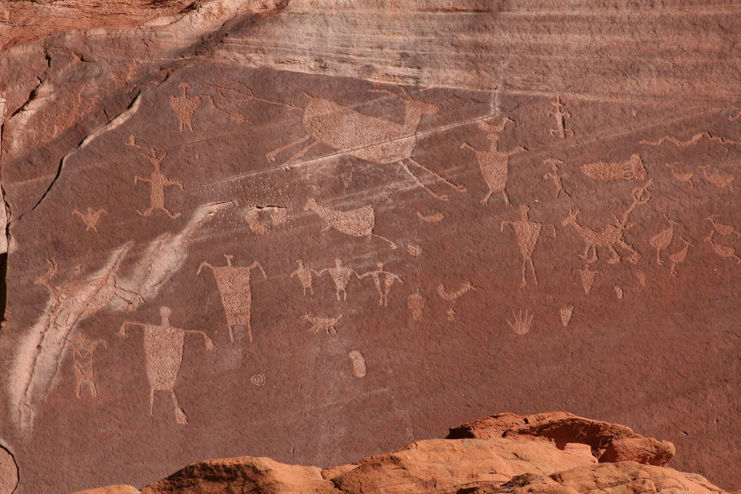 Rock art such as pictographs and petroglyphs, the latter seen here, can be found throughout the ...