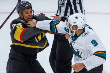 Golden Knights right wing Ryan Reaves (75) fights with San Jose Sharks left wing Evander Kane ( ...