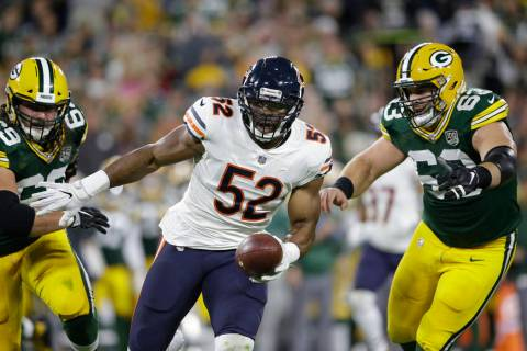 Chicago Bears' Khalil Mack intercepts a pass and returns it for a touchdown during the first ha ...