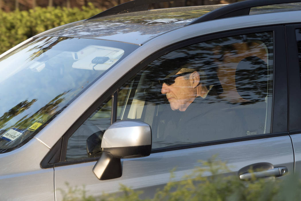 Special counsel Robert Mueller drives away from his Washington home on Wednesday, April 17, 201 ...