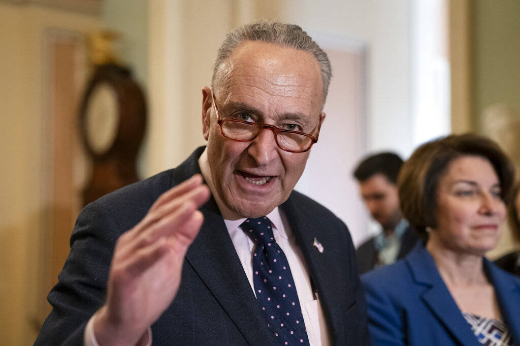 Senate Minority Leader Chuck Schumer, D-N.Y., joined at right by Sen. Amy Klobuchar, D-Minn., s ...