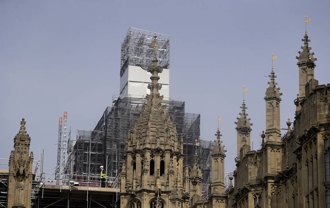 Britain's Houses of Parliament, covered in hoarding and scaffolding on Wednesday, April 17, 201 ...