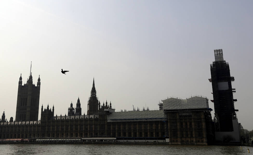 Britain's Houses of Parliament, covered in hoarding and scaffolding Wednesday, April 17, 2019, ...