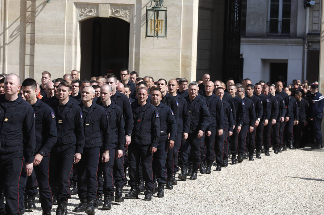 Emergency service personnel walk at the Elysee Palace in Paris after a meeting with French Pres ...