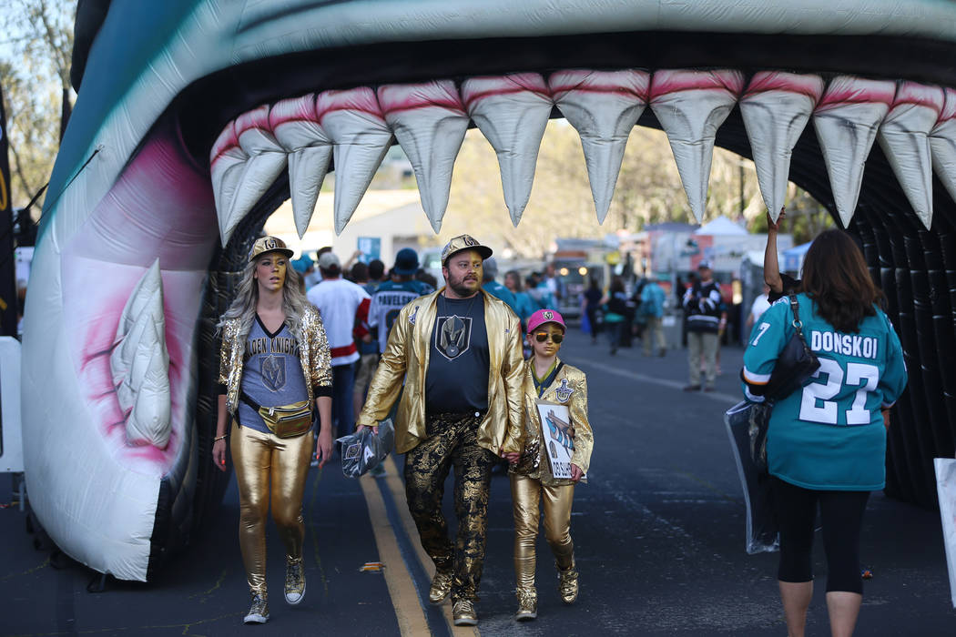 Casey Swank, from left, with Brad Ellis and his daughter Madeline, 11, from Las Vegas, walk out ...