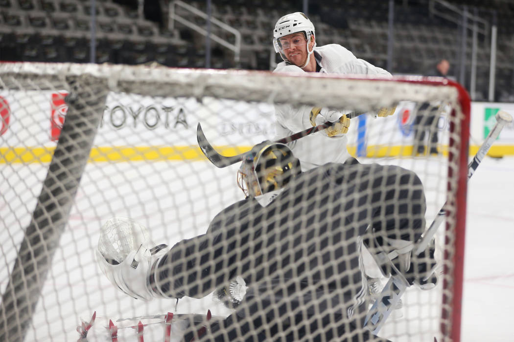 Vegas Golden Knights center Jonathan Marchessault (81) takes a shot during a team practice befo ...