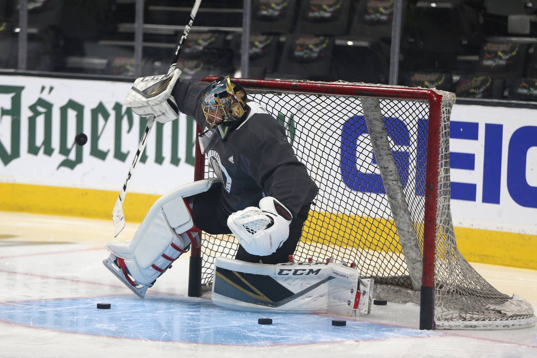 Vegas Golden Knights goaltender Marc-Andre Fleury (29) makes a stop during a team practice befo ...