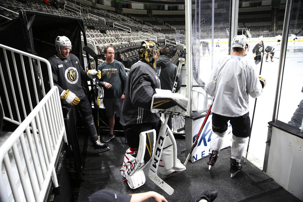 Vegas Golden Knights goaltender Marc-Andre Fleury (29), center, takes the ice for a team practi ...