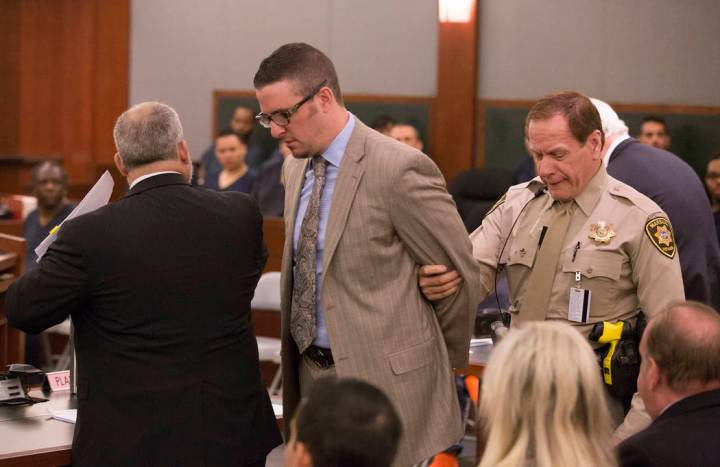 Defense lawyer Brian Bloomfield is taken into custody March 7, 2016, at the conclusion of a sen ...