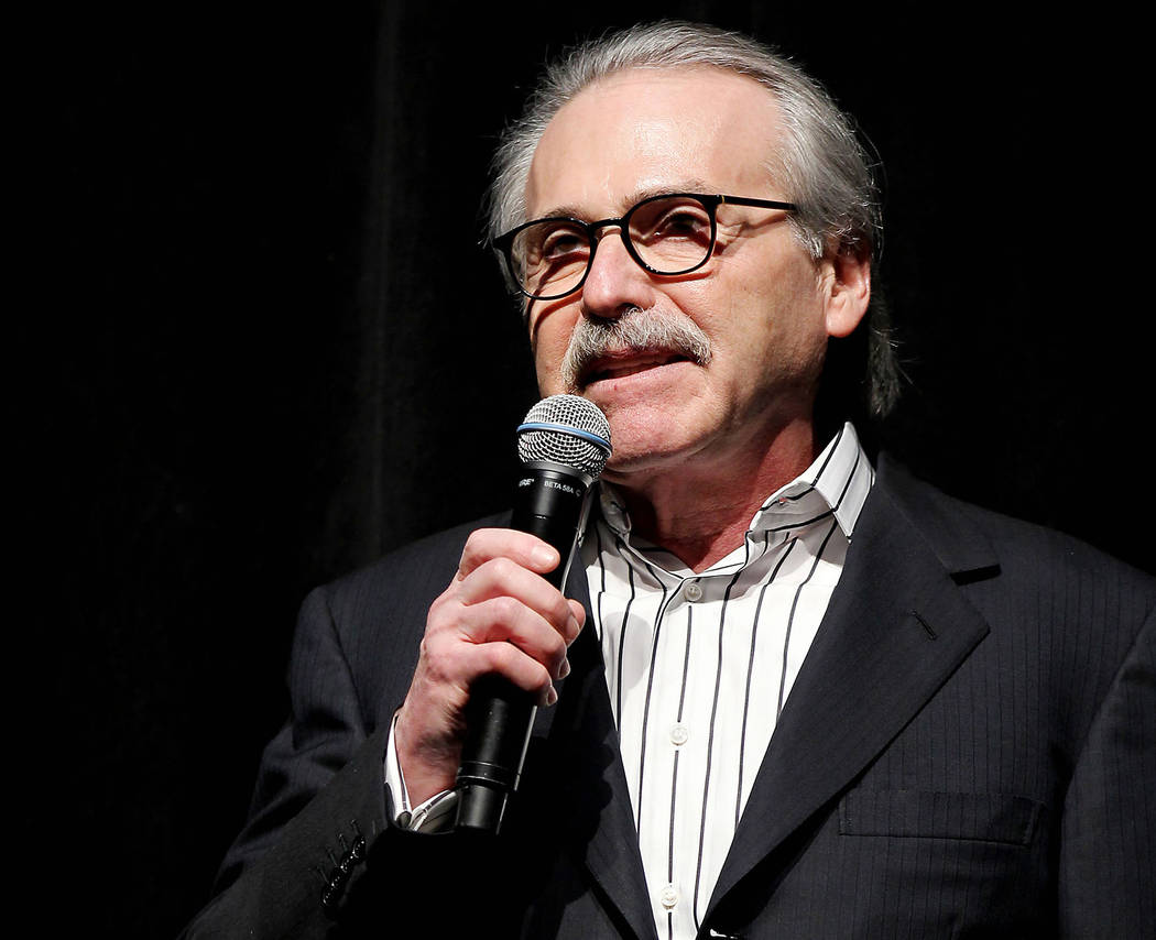 FILE - In this Jan. 31, 2014 photo, David Pecker, Chairman and CEO of American Media, addresses ...