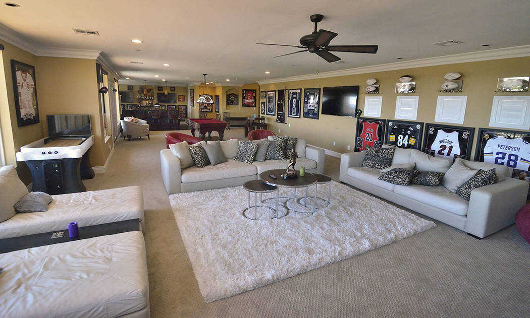A room on the top floor includes a bar, 75-inch TV and billiards and foosball tables. (Bill Hug ...