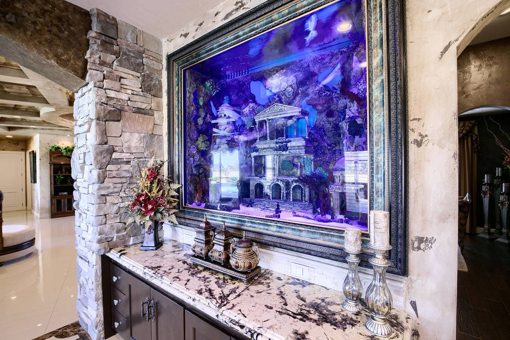 An aquarium sits in the kitchen of Brett Raymer's northwest Las Vegas home. (Signature Real Est ...