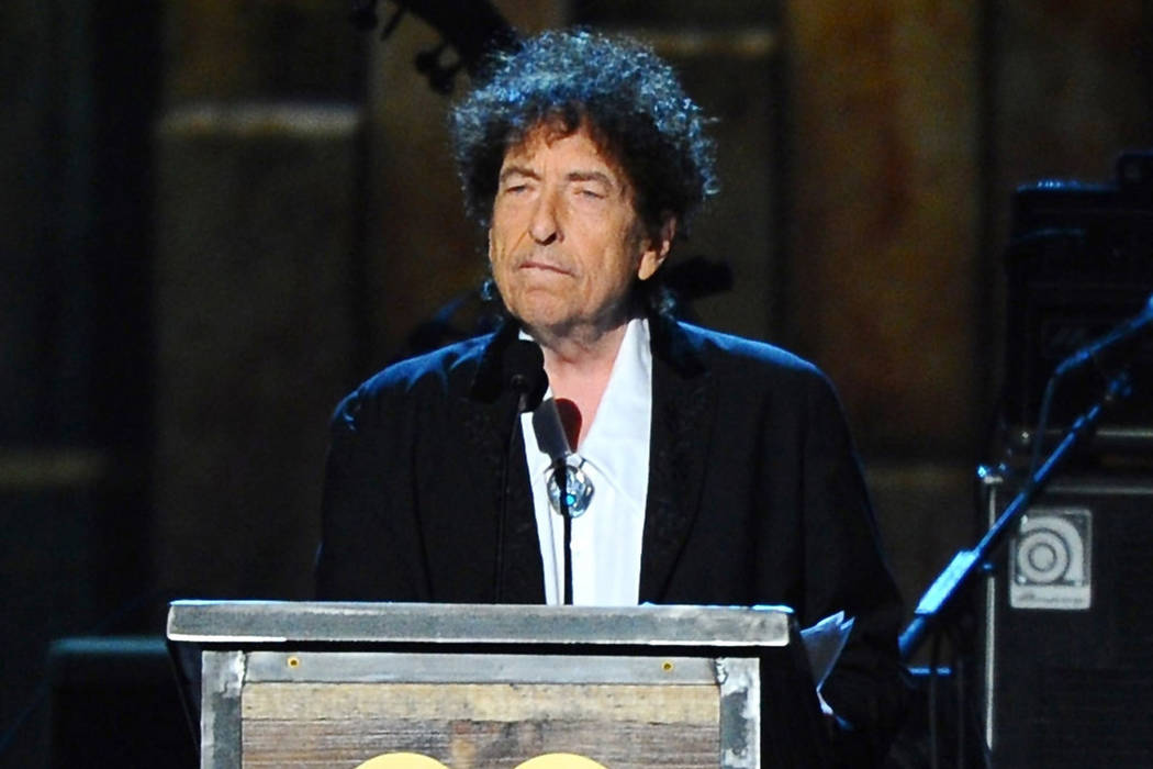 In this Feb. 6, 2015 file photo, Bob Dylan accepts the 2015 MusiCares Person of the Year award ...