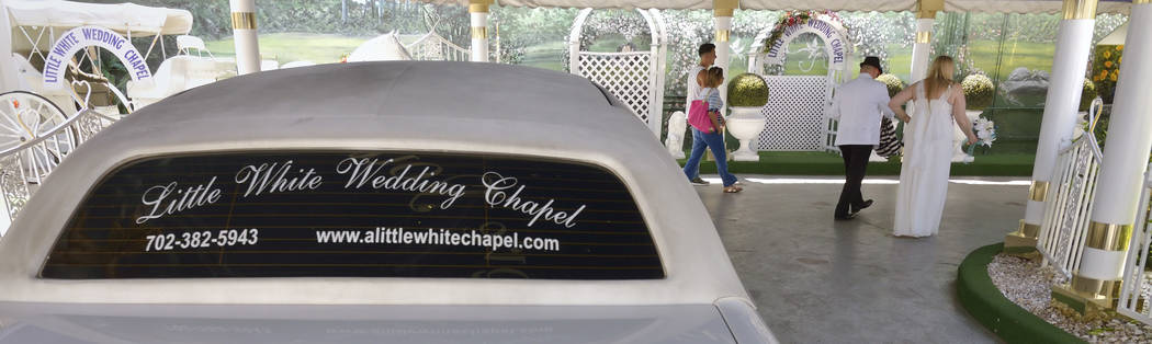 A couple heads into A Little White Wedding Chapel at 1301 S. Las Vegas Blvd. in Las Vegas on Th ...