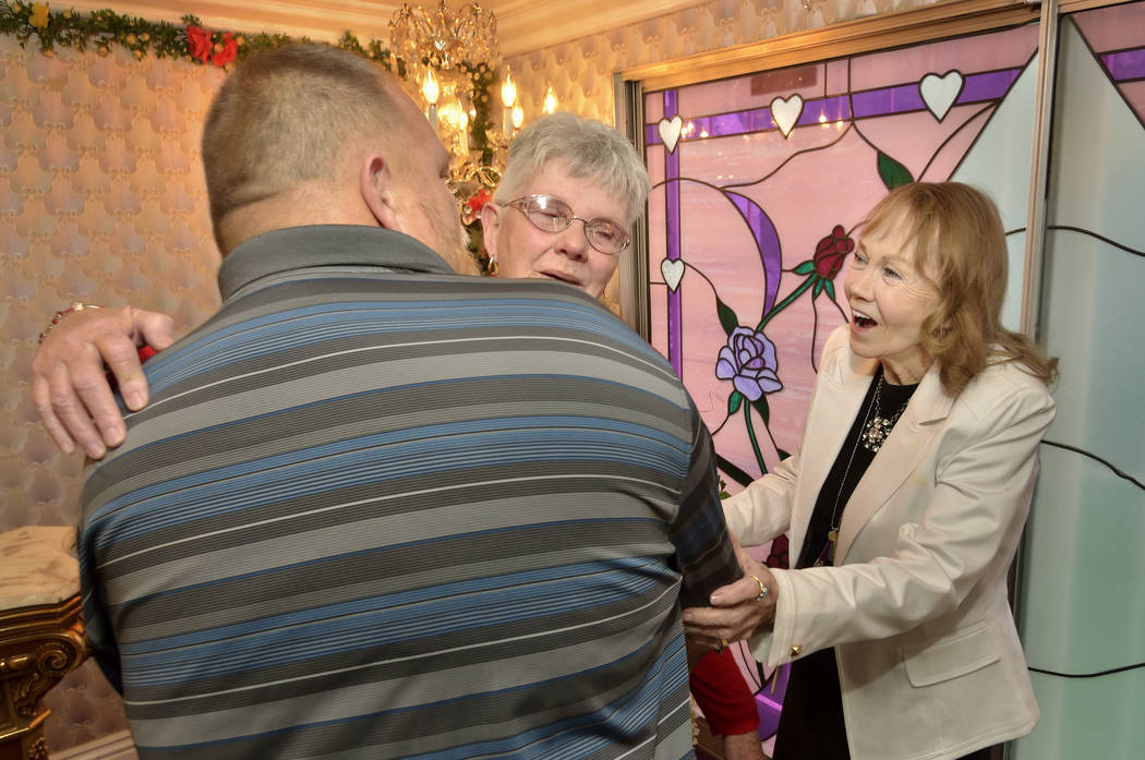 Charolette Richards, owner of A Little White Wedding Chapel, right, congratulates Thomas and Ma ...