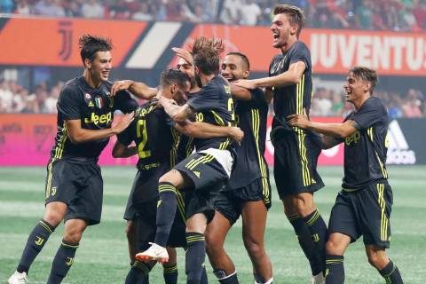 Juventus defender Mattia De Sciglio (2) celebrates with his teammates after scoring the winning ...