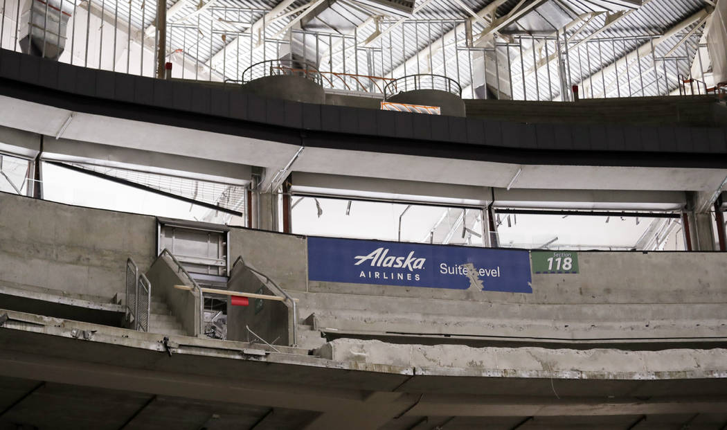 Seats are gone and concrete is partially torn away inside KeyArena in the early stages of demol ...