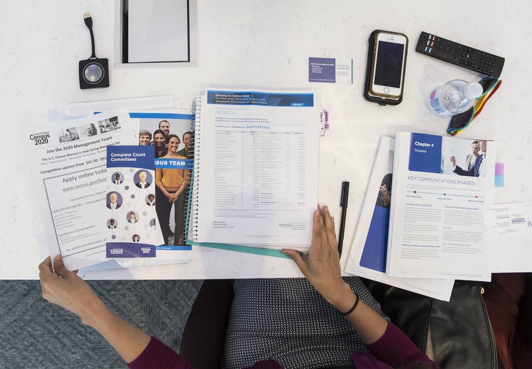 U.S. Department of Commerce partnership specialist Arlene Alvarez looks through her 2020 census ...