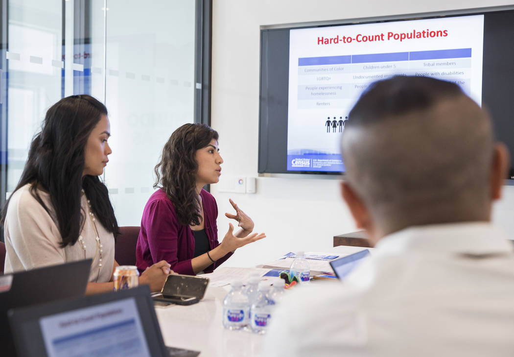 U.S. Department of Commerce partnership specialist Arlene Alvarez, middle, discusses the 2020 c ...