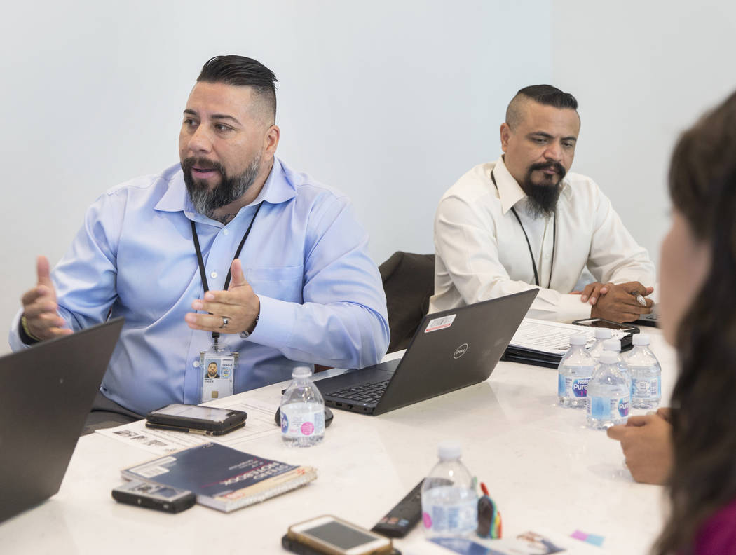 U.S. Department of Commerce partnership specialist Jorge Rangel, left, discusses the 2020 censu ...