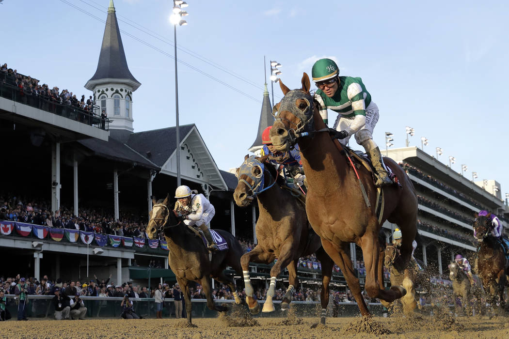 Joel Rosario rides Accelerate to victory in the Breeders' Cup Classic horse race at Churchill D ...