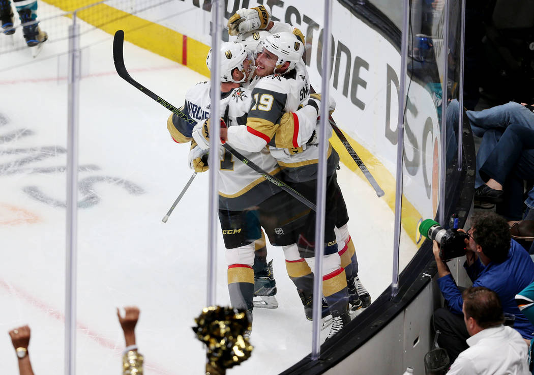 Vegas Golden Knights right wing Reilly Smith (19) celebrates a score with center Cody Eakin (21 ...