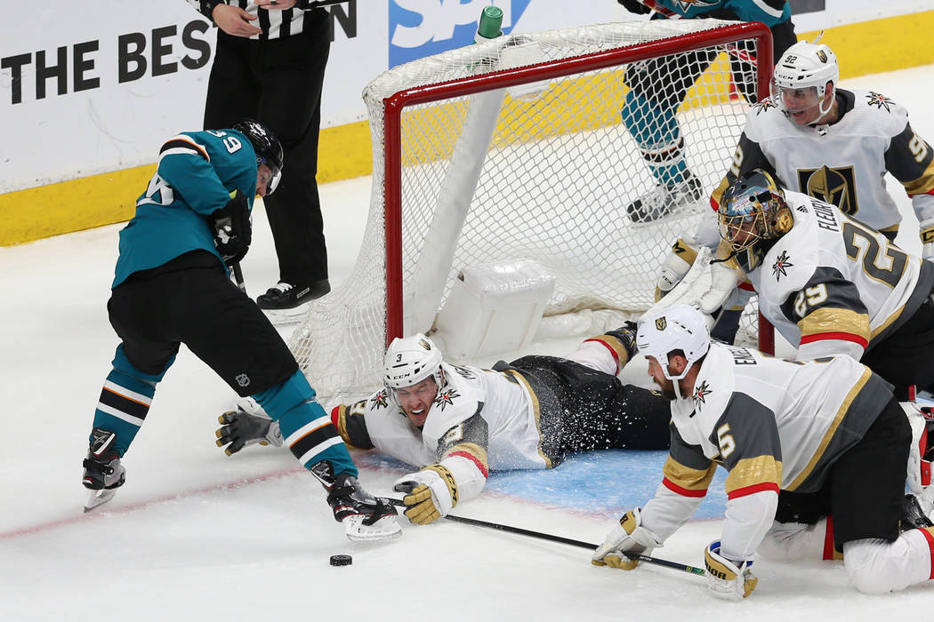 Vegas Golden Knights defenseman Brayden McNabb (3) defends against San Jose Sharks center Logan ...
