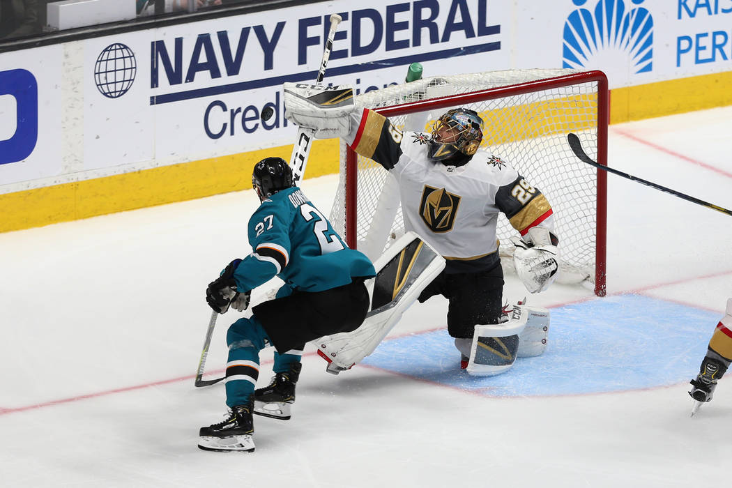 Vegas Golden Knights goaltender Marc-Andre Fleury (29) defends a shot from San Jose Sharks righ ...