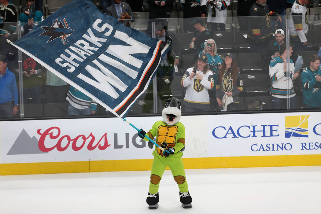 The San Jose Sharks mascot, S.J. Sharkie, celebrates the team's win 5-2 against the Vegas Golde ...