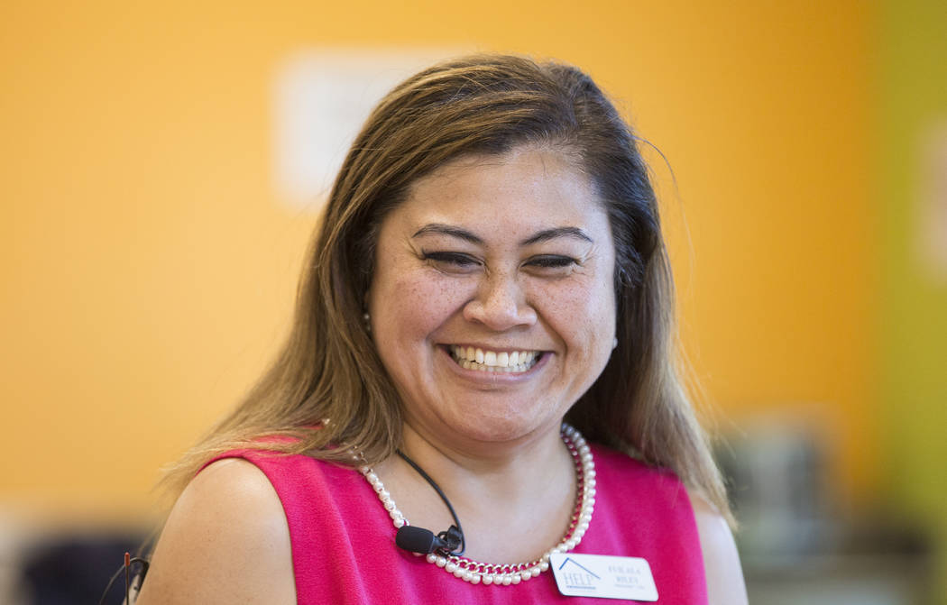 Fuilala Riley, president and CEO of HELP of Southern Nevada, shares a laugh with co-workers bef ...