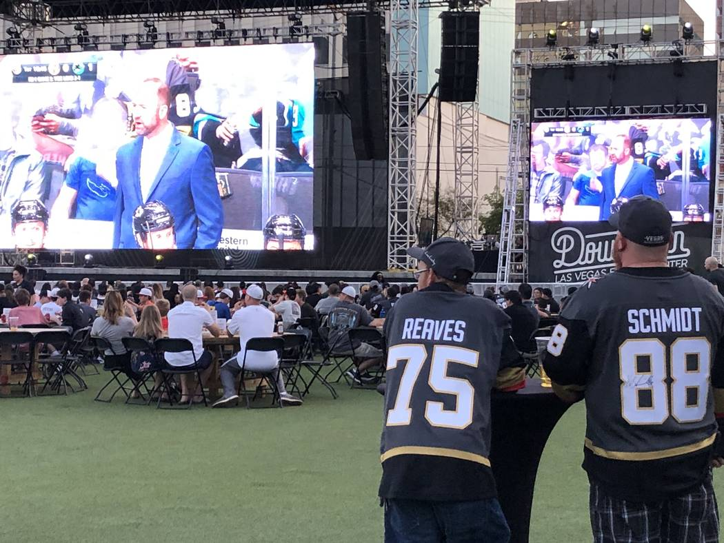Brothers Darren Navin, left, and Chad Navin preparing to watch the fifth game in the playoff se ...
