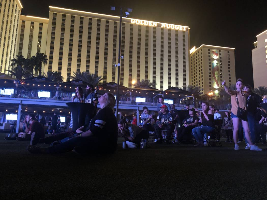 Fans watch on during the fifth game in the playoff series between the Las Vegas Golden Knights ...