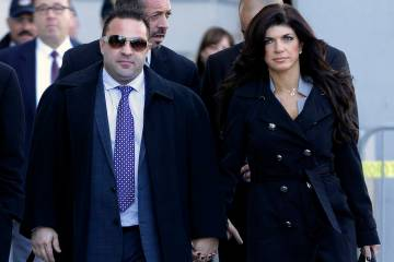 "FILE - In this Nov. 20, 2013, file photo, Giuseppe ""Joe"" Giudice, left, and his wife, ..."