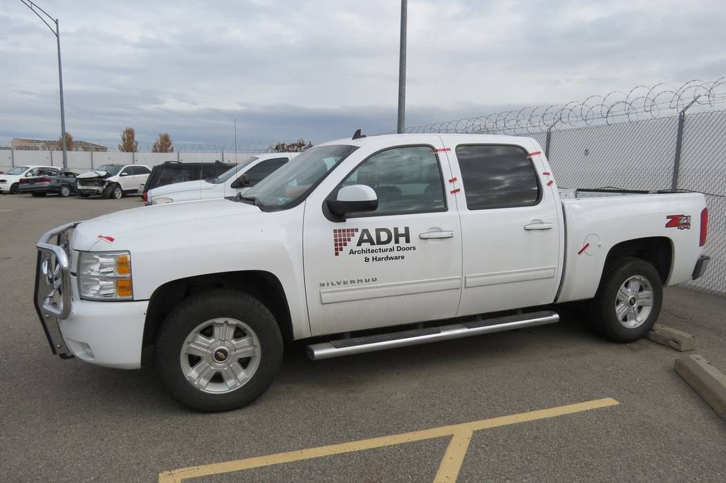 A 2012 white Chevrolet truck, matching the description of Green's work truck during the time, ...